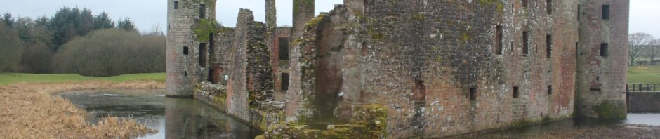 Caerlaverock Castle with moat and wood